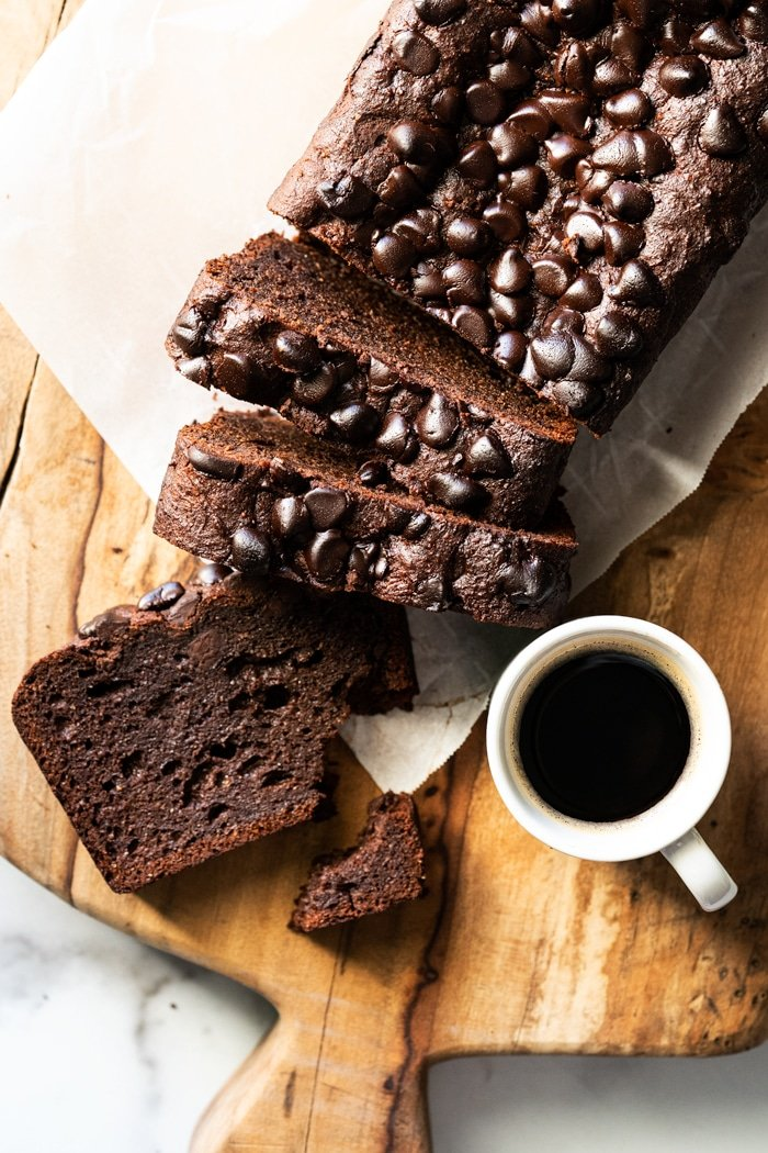 Sliced keto chocolate zucchini bread with a cup of coffee