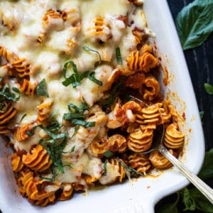 Keto cheesy pasta bake with radiatori in a white baking dish
