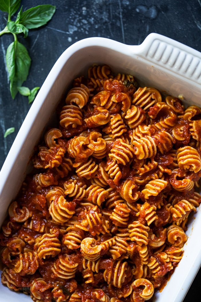 Keto radiatori shaped pasta with marinara sauce in a white baking dish