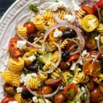 Keto pasta salad with cherry tomatoes on a white serving platter