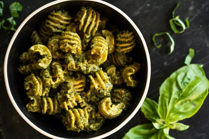 Keto radiatori pasta with pesto sauce and fresh basil