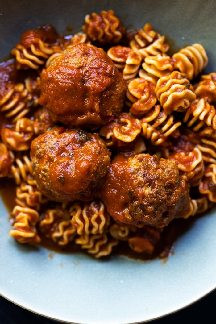 Keto meatballs with low carb radiator pasta in a green bowl