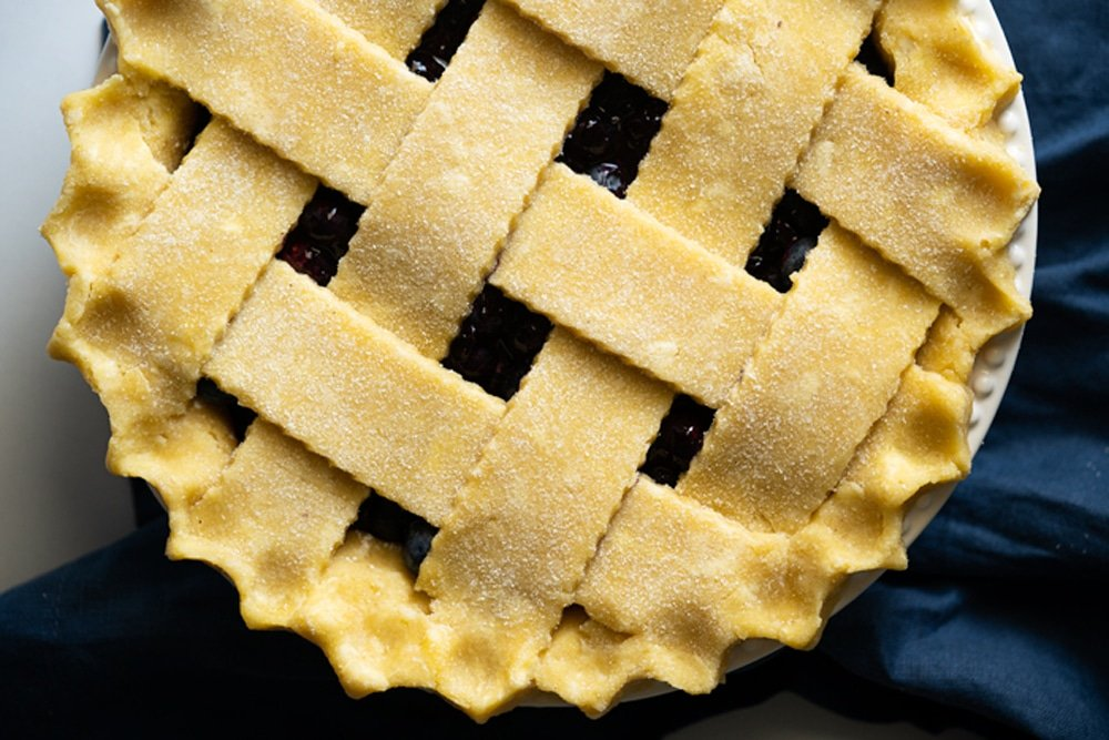 Overhead shot of a keto lattice pie crust with fluted edges