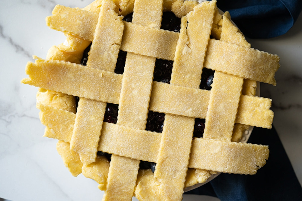 Overhead shot showing how to weave a keto lattice pie crust
