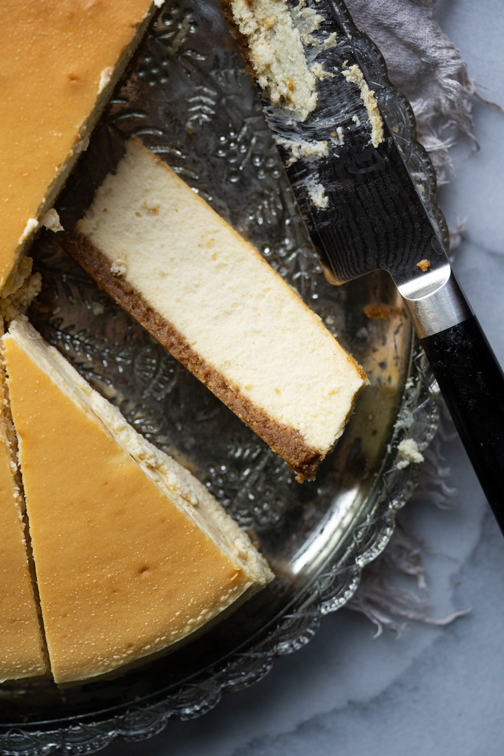 A slice of the best Keto Cheesecake showing a perfect creamy and airy texture