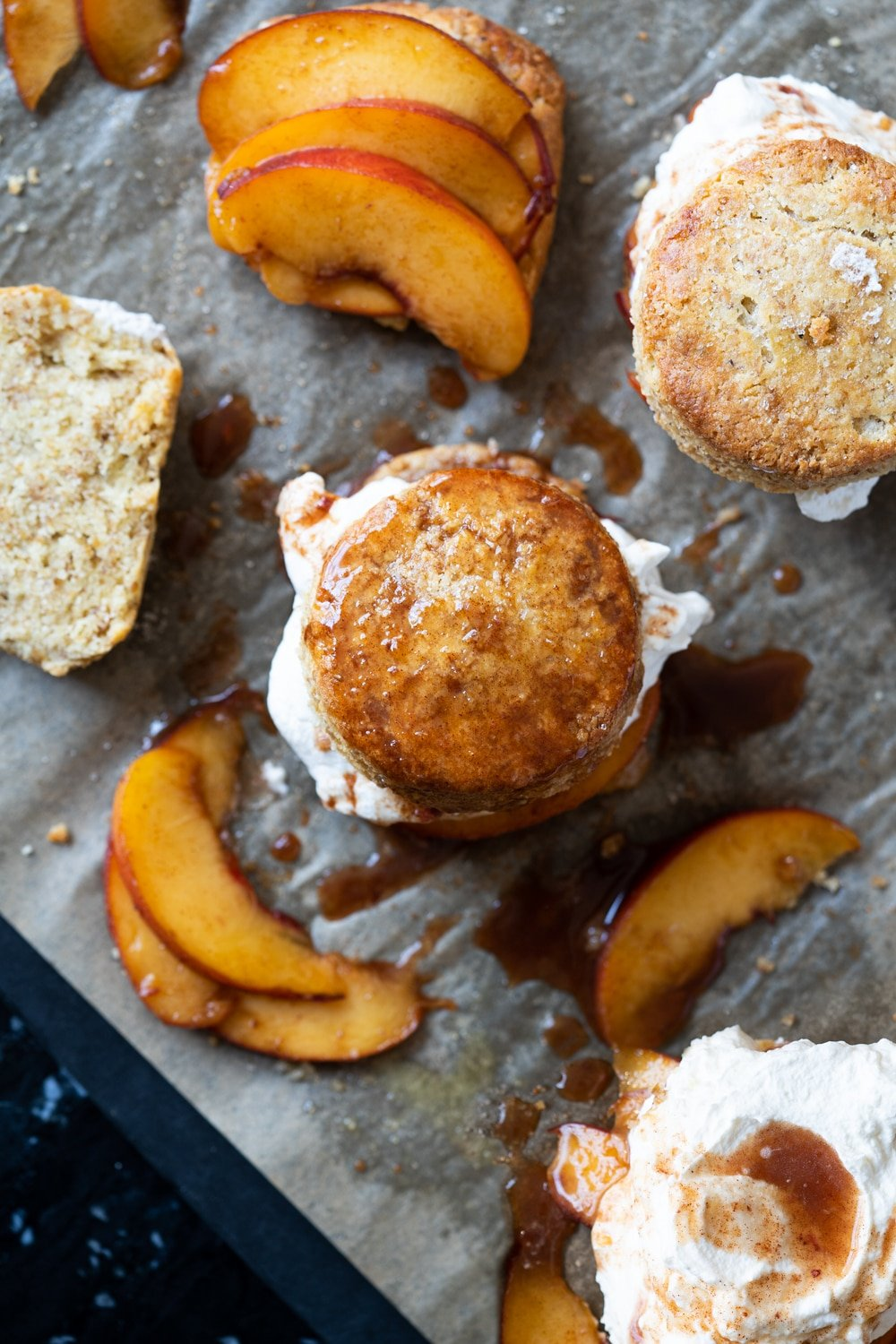 Overhead shot of keto peach shortcakes with peach slices and whipped cream