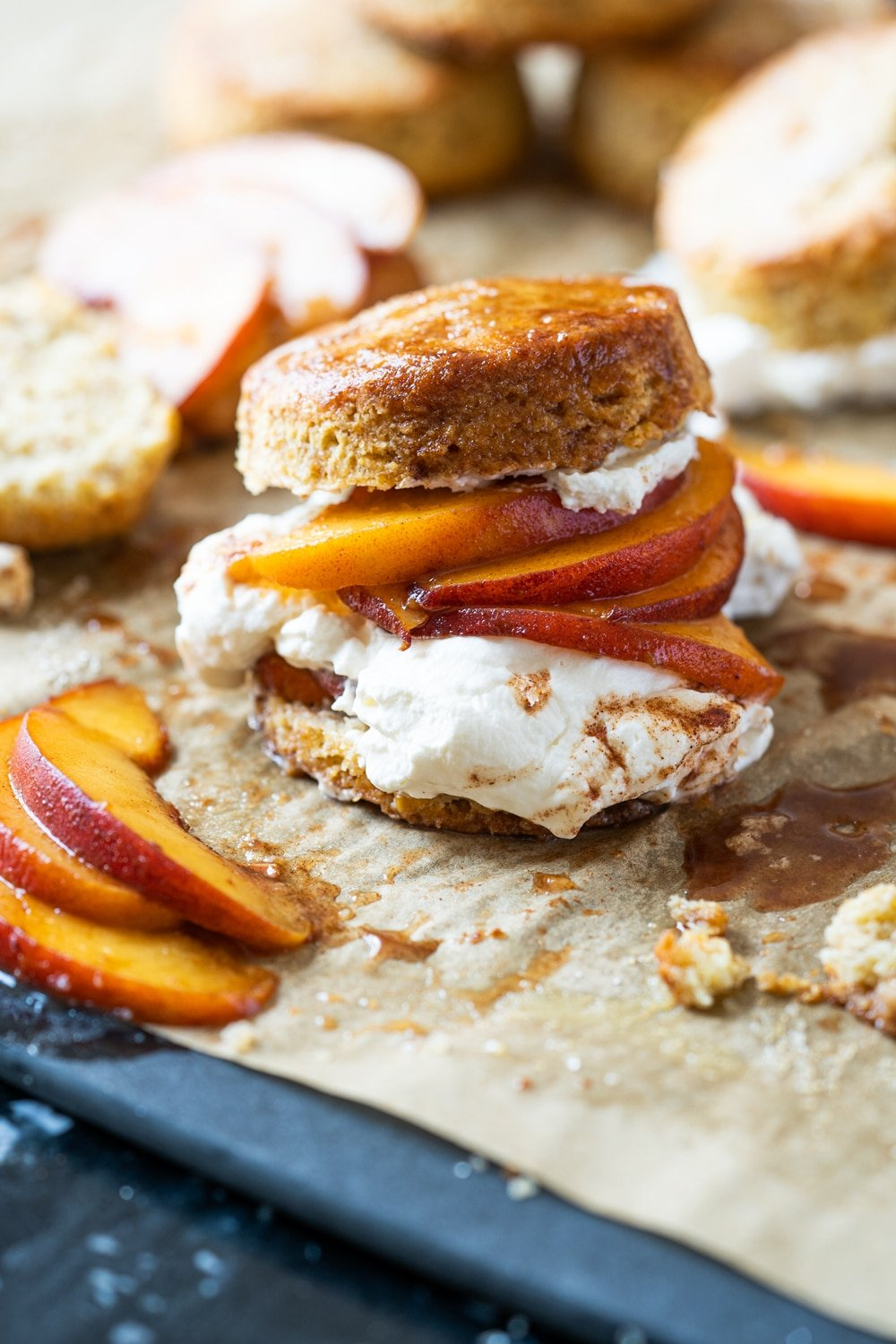 Keto peach shortcake with homemade maple whipped cream on brown parchment paper